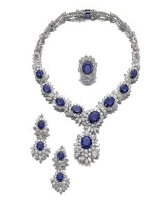 Attractive Sapphire and Diamond suite. Comprising: a necklace composed of flower head clusters set with oval sapphires and brilliant-cut diamonds, alternating with marquise-shaped stones, suspending at the front a detachable pendant similarly set; a pair of pendent ear clips; and a ring.