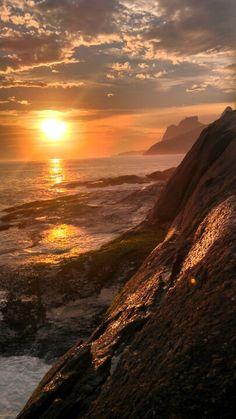 Sunset at Arpoador beach rocks, Rio de Janeiro, Brazil