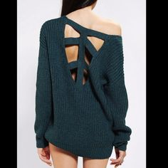 Urban Outfitters Blue Crossback Sweater Sparkle and Fade from Urban Outfitters. Size small but it would fit anyone small to large! Wore once to class Urban Outfitters Sweaters Crew & Scoop Necks