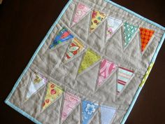 Bunting quilt...might be cool as a back?