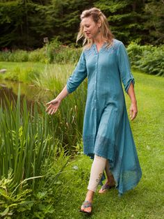 So. . . so elegant. A distinctly delicious garment that deftly blends old fashioned romantic sensibilities with a touch of Eastern mystique. Floral crochet insets above the bust and around the back are mirrored by the scallop finished crochet lace on the deep, asymmetrical hemline. Double buttons at the center back create a fabulous drape, perfect to pair with leggings or wear open over a dress.