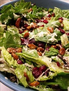 Cranberry Almond Lettuce Salad...  1 head romaine lettuce, 1 bunch fresh spinach, 1 cup dried cranberries, 3 green onions,   1/2 cup glazed almonds (instructions below), 3/4 cup fresh grated parmesan cheese....  Dressing-1/2 cup balsamic vinegar,   1/2 cup olive oil,  1/2 cup sugar,   salt and pepper...Glazed Almonds  2 tablespoons sugar,    1/2 cup sliced almonds