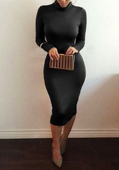 Full front shot of model in black turtleneck midi dress