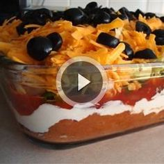 Seven Layer Taco Dip | A taco dip made with refried beans, sour cream, and salsa is the perfect platter for parties and family get-togethers.