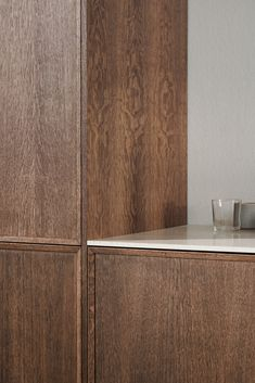 Note Design Studio's kitchen design FRAME in dark oak for Reform. It's an IKEA hack.