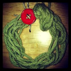 Christmas finger knit wreath ornament for one top of presents