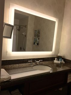 Bathroom lighting all around the mirror- great for putting on makeup!