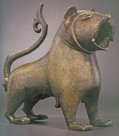 An engraved bronze fountain spout in the shape of a lion made in 13th-century Spain/Andalusiathe Louvre, Paris.