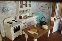 Diary of a Dollhouse -- bought the kitchen set from Miniatures.com.  I decided the fridge was to big for the scene so I made a Smeg fridge from a Michaels wooden box.