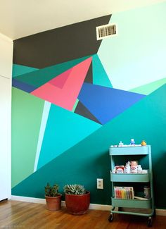 Transform a wall in your home into a work of art! All you need to create this geometric design is paint from Sherwin-Williams, painters tape and patience.