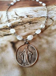 So Far Away - Vintage Medal with Oxidized Sterling Silver Necklace - Moonstones. $79.00, via Etsy.