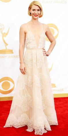 At the 65th Primetime Emmy Awards, Homeland star Claire Danes accepted an Emmy for Outstanding Lead Actress in a cream-colored plunging embr...