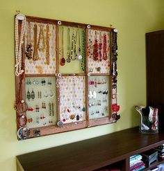 Multi-panel...using chicken wire and hooks, knobs on frame