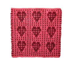 This heart dishcloth/washcloth is created using a fairly easy slip stitch pattern. Although it appears that you are using 2 colors per row, you are in fact only using 1! Every row is done using a combination of knit stitches and slip stitches. You knit two rows using color A, then two rows using color B. You alternate throughout. It makes the perfect gift for someone you love!