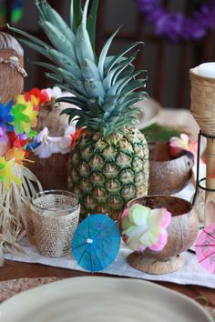Fresh pineapple with tropical decor from #Goodwill makes a fun table setting for a #Hawaiian themed party. #entertain #thrift