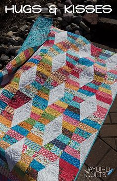 It's the new Hugs & Kisses quilt pattern from Julie Herman of Jaybird Quilts. The cover image for the pattern features the latest Oliver + S fabric collection, Modern Workshop.