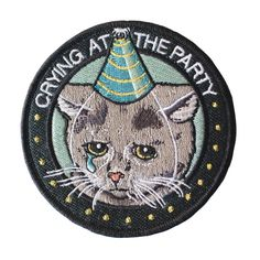 For all the sad cats at the party.Collaboration between Stay Home Club and Allison Weiss. Embroidered patch design Iron-on backing Detailed, high-density embroidery Merrowed edge stitching Measurements: diameter By Stay Home Club Cool Patches, Pin And Patches, Iron On Patches, Jacket Patches, Embroidery Designs, Cat Patch, Sad Cat, Embroidery Patches, Embroidered Patch