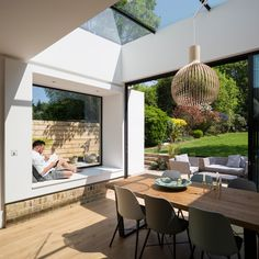 Interior Bright Extension - Campbell Cadey - Woodland Pavilion Clean lines work wonders on this rear brick extension to a London family home, with sliding glass doors and a window seat. Brick Extension, House Extension Plans, House Extension Design, Extension Designs, Glass Extension, Rear Extension, Extension Ideas, Kitchen Diner Extension, Open Plan Kitchen Diner