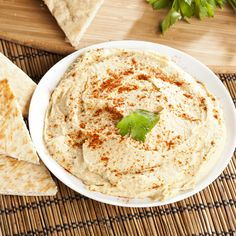 Make this delicious Homemade Hummus Recipe to snack on, or use it on sandwiches for a healthy spread.data-pin-do=