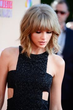 Taylor Swift's mullet lob was the perfect blend of edgy and chic at the iHeartRadio Music Awards. Taylor is perfect hair inspiration for short-haired women!