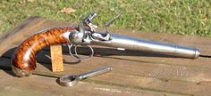 """Queen Anne """"turnbarrel"""" pistol. This style of pistol was one of the many early attempts at a breech loader. The barrel would unscrew with the circular key and powder would be poured into the chamber and the ball pressed on top of cone-shaped chamber. The shooter would then screw the barrel back on and prime the pan..."""