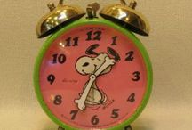 pink and green Snoopy alarm clock