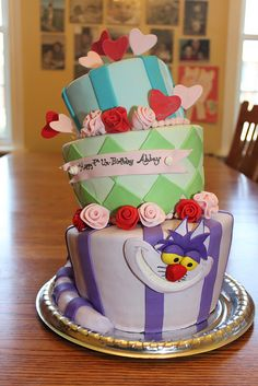 Mad Hatter cake- cheshire cat by lisafemmefondant, via Flickr