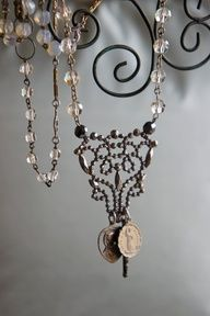 Rosary beads and religious medals.