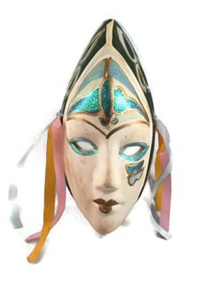 Beautiful VINTAGE mardi gras mask.    I believe it is made of ceramic and has pink, orange and blue ribbon attached through two small holes on the sides for wall mounting. ... #etsysale #shopsmall #vintageshop #vintagelife #vintagelover #housewares