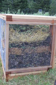 Three bin compost system, from one end.  Critter-proof.