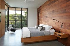 Wooden walls and polished concrete floors. Layered fabrics and pallette - beautiful windows and i love the differrent timbers together. Floating bedside is very classy