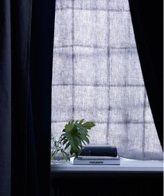 A dark-blue soundproofed curtain hanging at the window blocks out outdoor noise as well as daylight. Combine with blackout curtains for extra sun-blocking power.