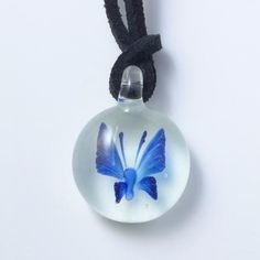 Glowing glass butterfly pendant necklace