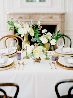 gold vases with whites and greens