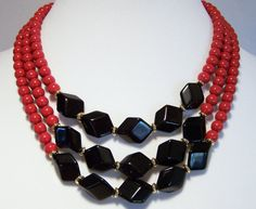 Vintage Crown Trifari 6855 Lucite beaded necklace •Round burgundy or dark red beads, with larger black stylized rectangular beads •Etched gold tone triangle hook closure •S... #vogueteam
