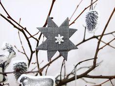 Звезда из ткани сложена по принципу оригами. Для надежности прихватила немного ниточками.