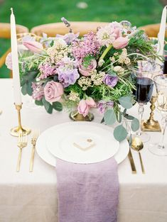 Romantic lavender hued centerpiece: http://www.stylemepretty.com/virginia-weddings/leesburg/2016/05/30/wine-crepes-and-lavender-all-things-french-live-in-this-provencal-wedding-inspiration/   Photography:Alicia Lacey Photography - http://alicialaceyphotography.com/