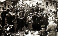 King George VI and Queen Elizabeth visit the bombed streets of East End of London - 23 April 1941