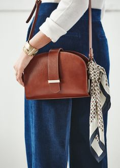 SHOP  Moon-shaped cross-body bag with a statement buckle and vintage sheen  to the leather, love! By Sezane. 6f2f2c29bc3