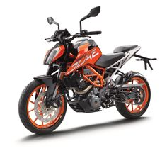 KTM 390 DUKE -- Building on and refining their popular small road bike, KTM have updated the KTM 390 DUKE with a mix of performance and aesthetic changes. The most obvious change is a new larger 13.4 litre (3.5 gallons) tank and head light, featuring a sharper design and new graphic. Underneath, the 2017 390 DUKE gets a new bolt-on rear subframe. An updated instruments package includes a bright TFT multicolour display.