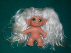 Had a big collection of troll dolls, loved to comb their hair...