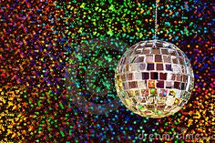 A silver mirrored disco glitter ball against a colorful sparkly background.