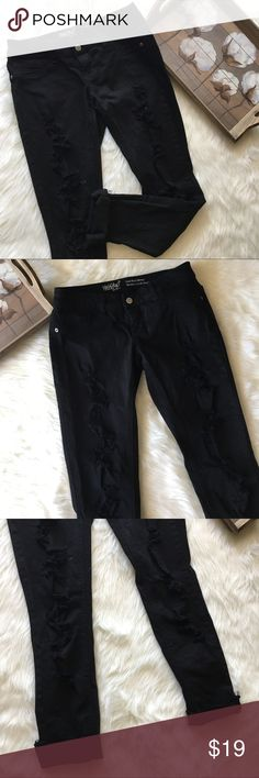 Mossimo  Black Distressed Low Rose Skinny Jeans Super chic and stylish Denim Mossimo Black low rise skinny jeans in excellent preowned condition. Size 2. Distressed down the legs! Mossimo Supply Co Jeans Skinny