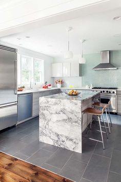 The sleek, modern kitchen is by Poggenpohl.
