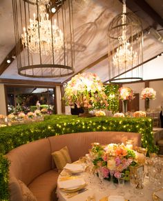 Love the hedge, birdcages over chandeliers, and the lounge furniture!