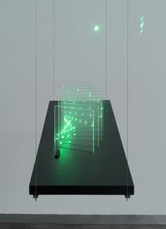 Erwin Redl Breath of Light (curved), 2014, acrylic, green 5mW laser, black PVC, microprocessor, 25.4 x 76.2 x 15.2 cm