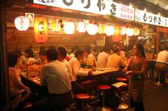 People enjoying friday night at Ton Ton Yakitori bar, Ginza