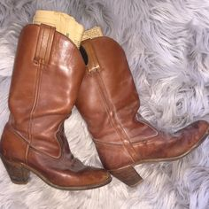 Vintage Cowgirl Boots Size 8.5 in women's.  Super cute and need cleaned (slight discolor, but some is dust-I don't want to ruin these so I will not clean them) made in the USA and absolutely a gorgeous vintage piece for any wardrobe! Old newspapers kept inside to keep the boot sturdy. These boots are from the 80's by a brand name Dexter. More of a cognac color/brownish Dexter Shoes