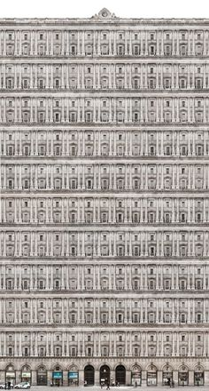 Infinite Palaces & Buildings, Fabiano Busdraghi. A series of large-format photographs (up to 10 metres wide) of buildings where the windows become an element which is repeated ad infinitum. The windows of a building are photographed almost one by one and then are mounted together on a computer-based repetition, thus creating a gigantic collage.