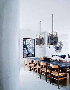 "House tour: a sophisticated beachside Sydney home: ""With driftwood tones and shards of white, the colours relate to the colours of the ocean,"" adds Hare. Meanwhile, the Joshua Yeldham print in the living and dining area and the dark pendants over the dining table create contrast that anchors the airy open plan."